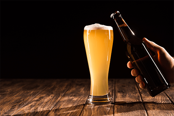 Pouring a Blue Moon beer